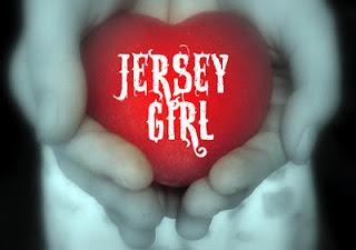 JERSEY GIRL HEARD HOLDING IN HAND